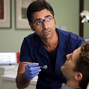 John Stamos as a dentist in an episode of Glee