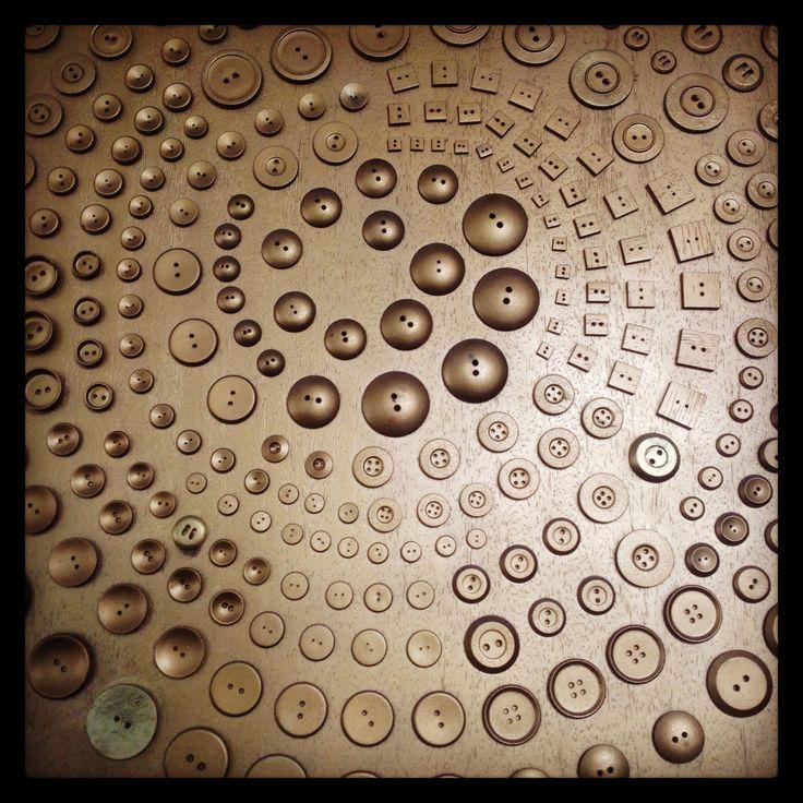 Button art in Aarikka meeting room.