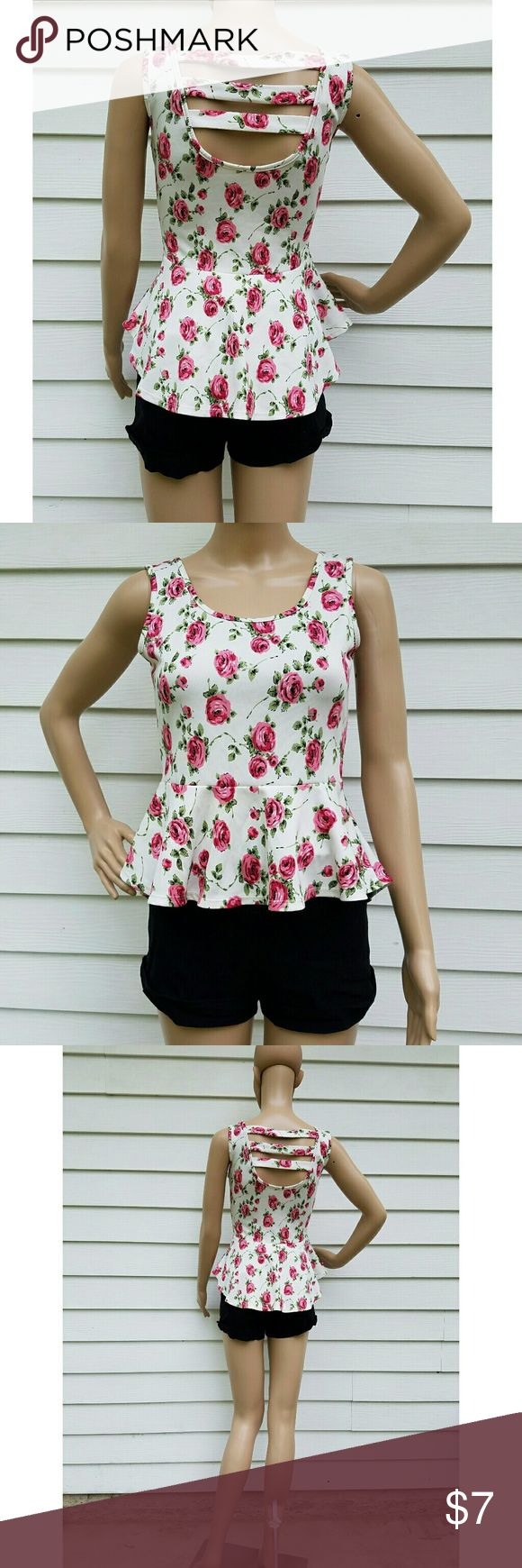 "Cute floral white peplum top Size 6 Good condition  Mannequin size is 6 Mannequin height is 5'6""  Check out my other items for sale  #top #peplum #whitetop #summertop #summer #peplumtop #floralshirt #shirt #sleeveless #openback Tops"