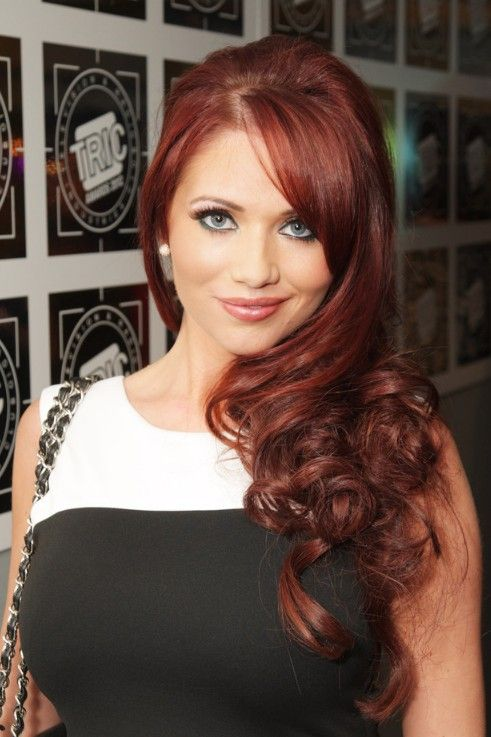 Amy Childs curly red hair with side swept bangs