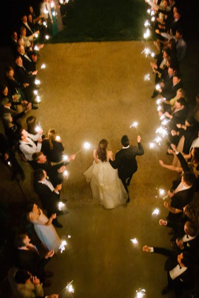 A fun send off for the bride and groom - all of the guests line the exit and hold sparklers.
