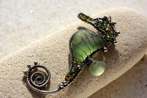 koru #243... Tiny olive seahorse wire wrapped seaglass pendant by palmeras. Really wish I had seen it before it sold...
