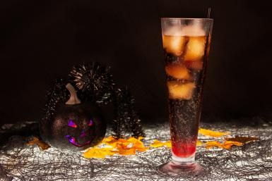 An Easy Cola and Black Cherry Vodka Drink for Halloween: Mix black cherry vodka and grenadine with cola and you have yourself a Dracula's Kiss.
