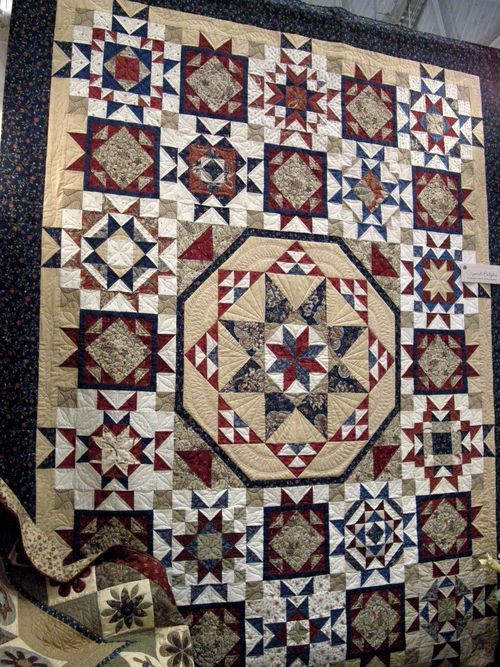 Country Sampler Quilts.  I like the center as a small wall hanging idea.