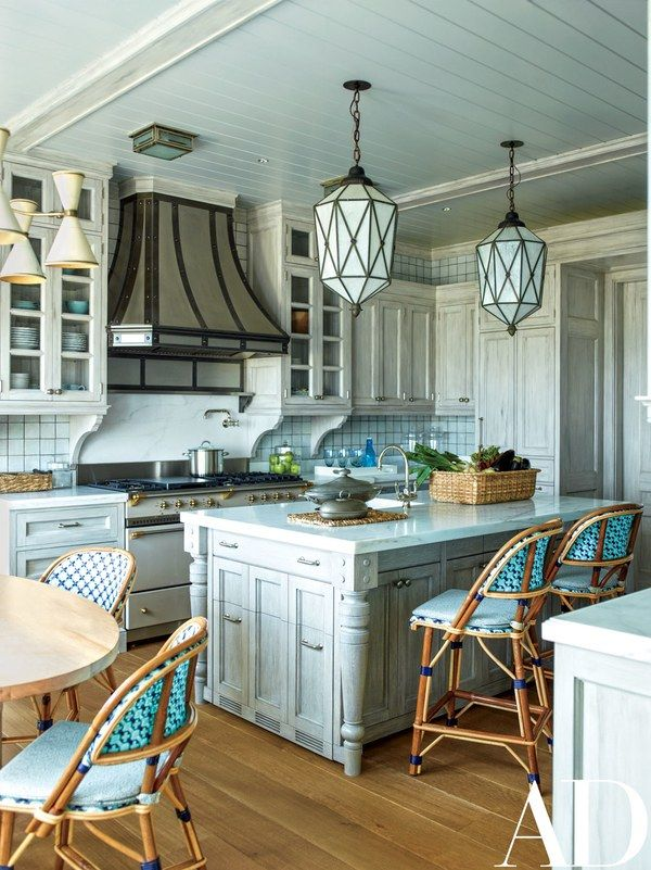 In a Hamptons house designed by Steven Gambrel, the kitchen is appointed with a RangeCraft hood, a Lacanche range, and cabinet hardware by Sun Valley Bronze | archdigest.com