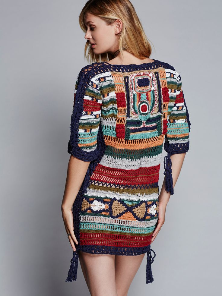Sybilla Dress   This retro-inspired short sleeve multi-colored crochet dress features a plunging V-neckline and fun tassle details.
