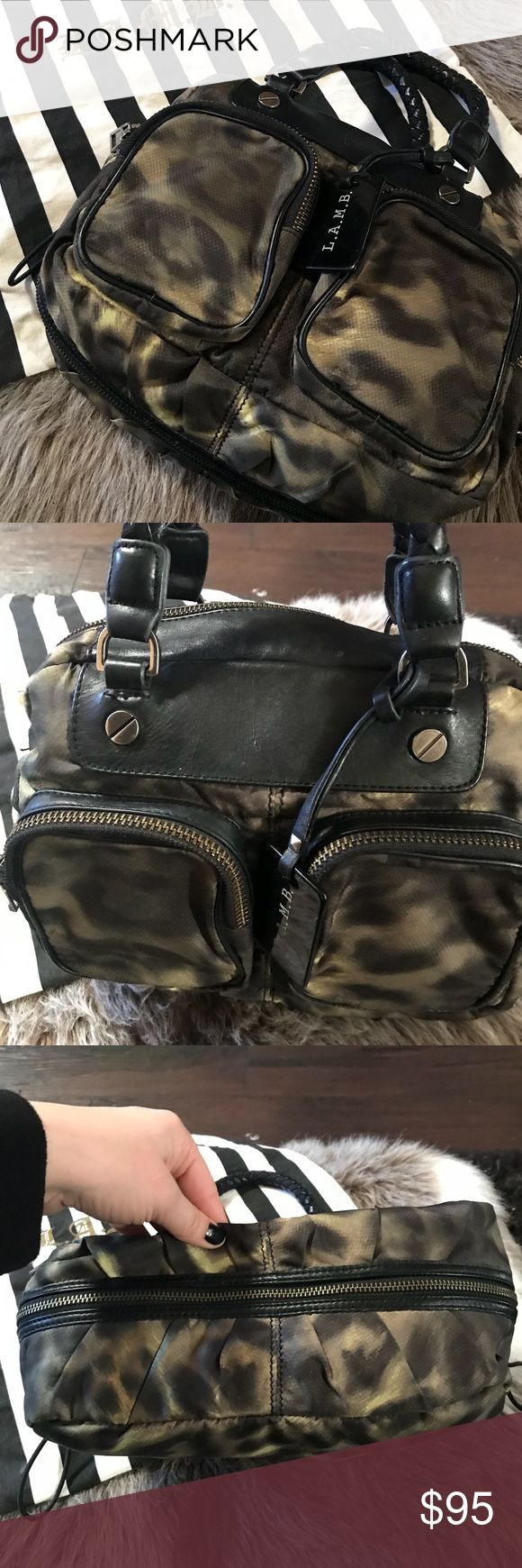 L.A.M.B leopard print bag Leopard print nylon like fabric with black leather accents. Very gently used bag. Please see pictures for imperfections. Comes with dust bag. L.A.M.B. Bags