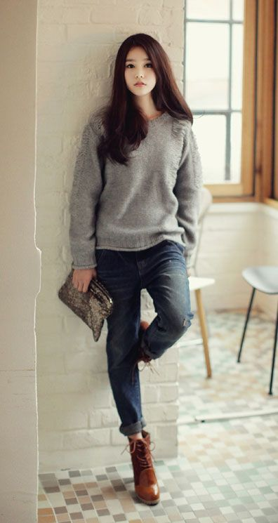 simple grey cosy sweater and jeans. minimalistic style.