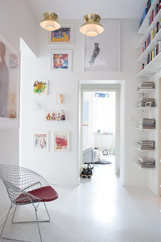 white hallway, shelves + art