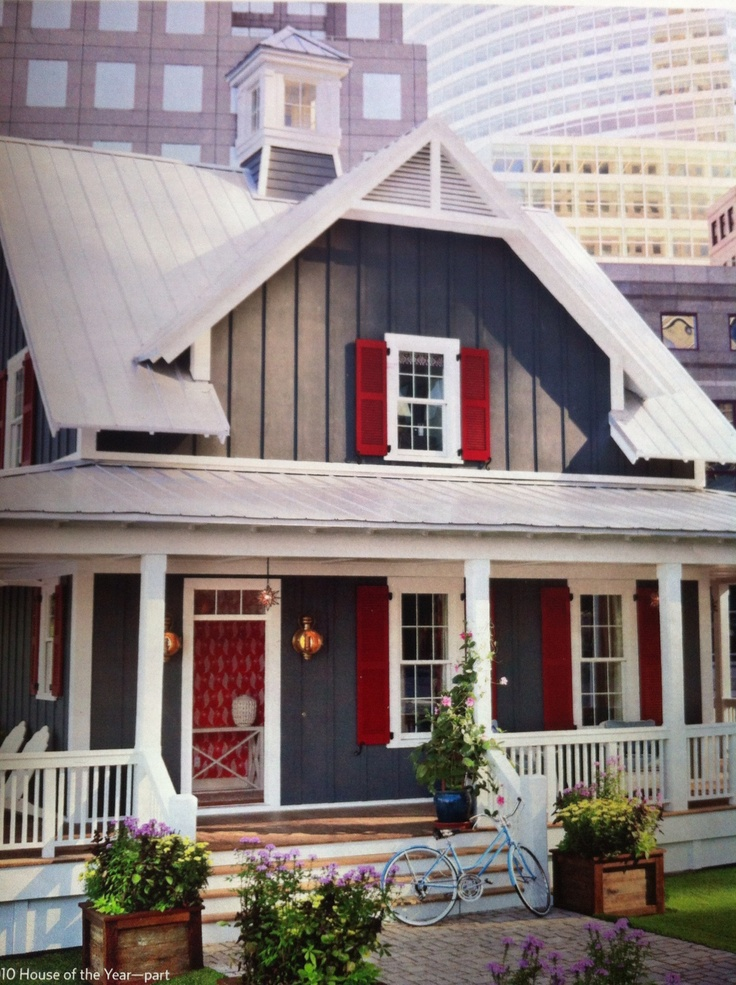 Gray batten board siding, white trim and red shutters <3