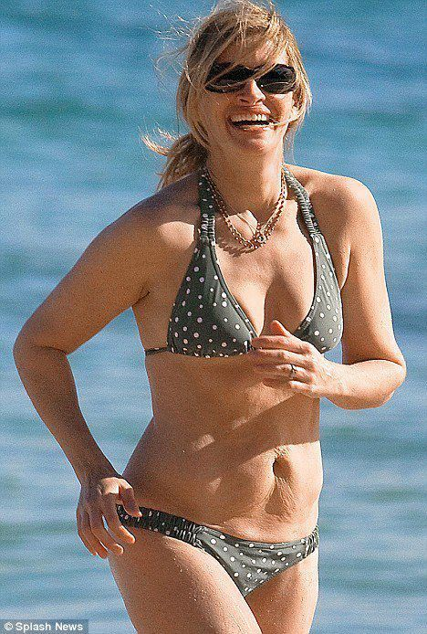 "Julia Roberts, proudly and confidently showing off her beautiful belly and the ""twin skin"" as evidence that two babies grew there at once! :-)    For more inspiration, plus lots more, sign up for our e-newsletter at www.bellysprout.com!"