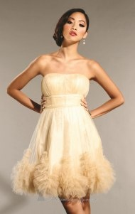 cream ruffled party dress. so pretty :)