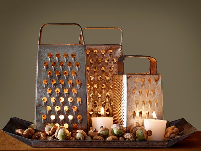 Use old box graters to create this lovely table display.