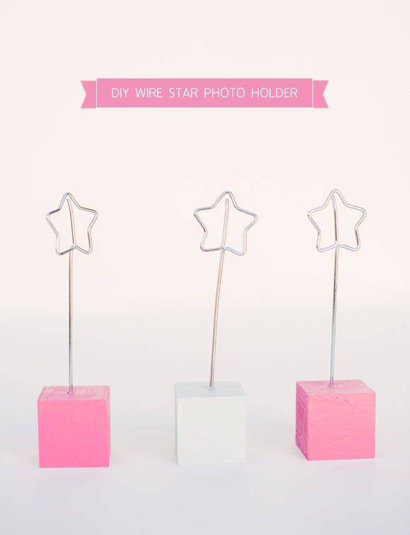 DIY Wire Star Photo Holder // These,  but worth hearts or swirls to hold pictures around the reception.