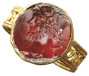 A carnelian intaglio ring. Roman, 2nd-3rd century AD.  Seal with flat surface depicting a laureate head of Septimius Severus