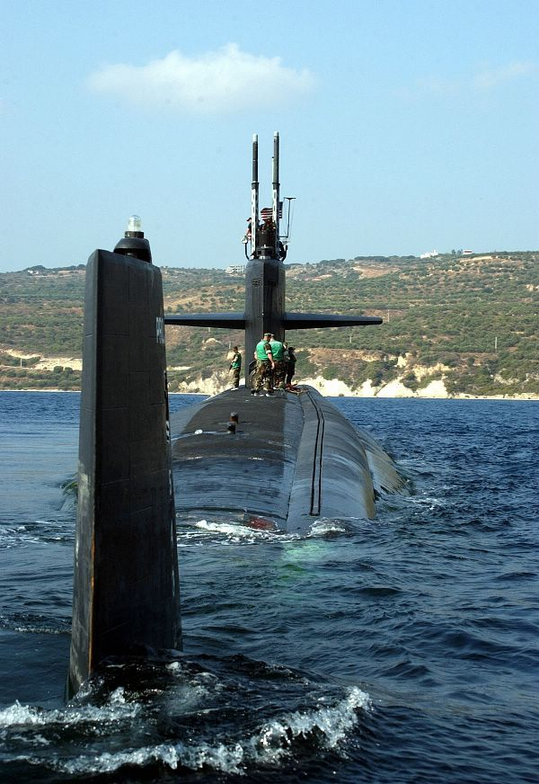 Souda Bay, Crete, Greece (Oct. 25, 2004) - The Los Angeles-class attack submarine USS Newport News (SSN 750), departs Souda Bay harbor, Greece. Newport News is homeported in Norfolk, Va., and is currently on a scheduled deployment. U.S. Navy photo by Paul Farley (RELEASED)