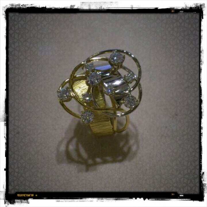 Jewels. Handmade ring in white and yellow gold with diamonds.  www.gioiellisoprana.it