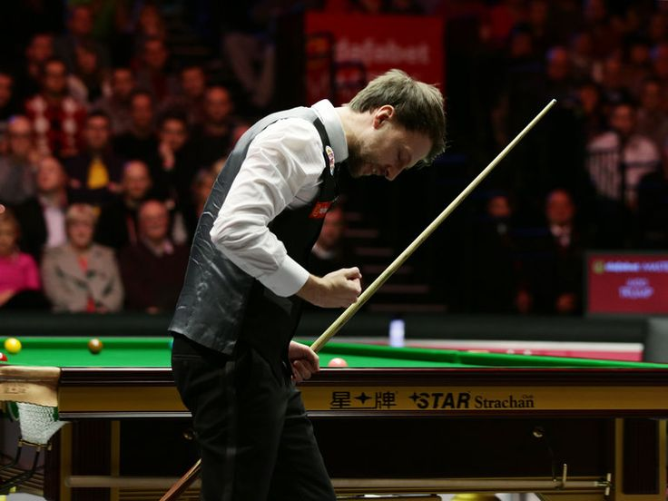 Judd Trump celebrates towards the end of a thrilling match