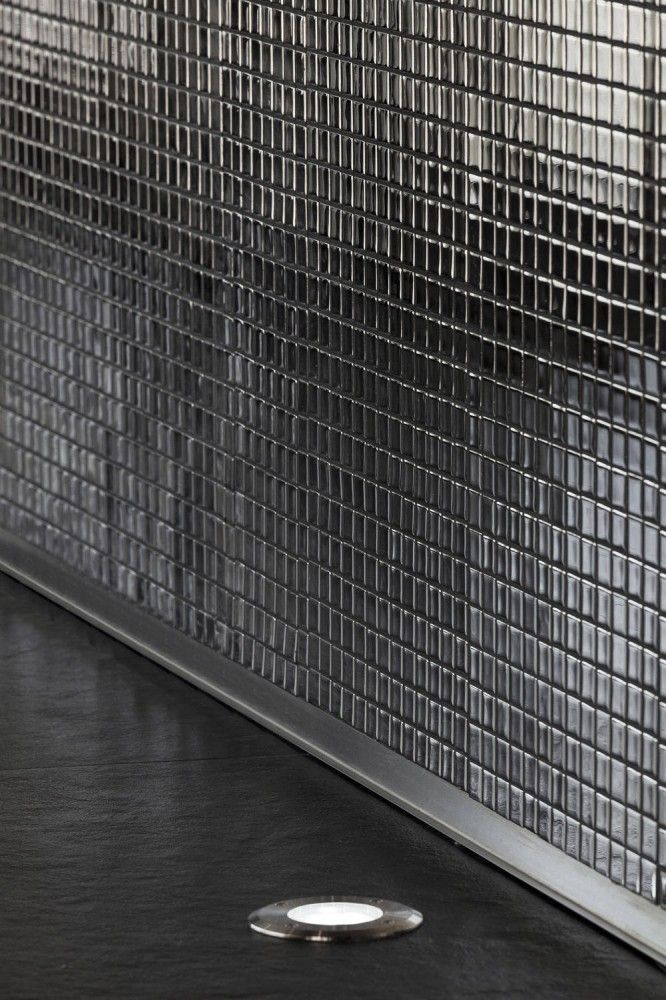 Mirrored black mosaic tiles in shower room - my son would like this!