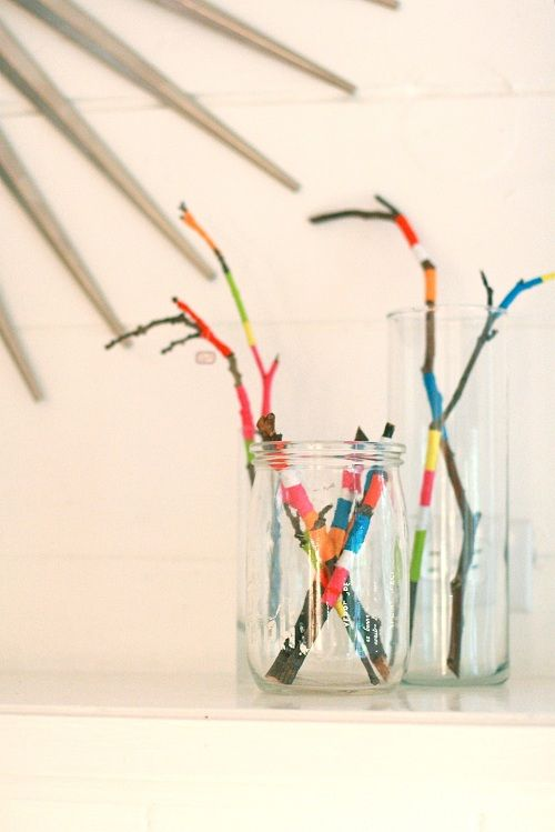 Bored kids? Wrap twigs and branches with embroidery thread for a centerpiece. #DIY