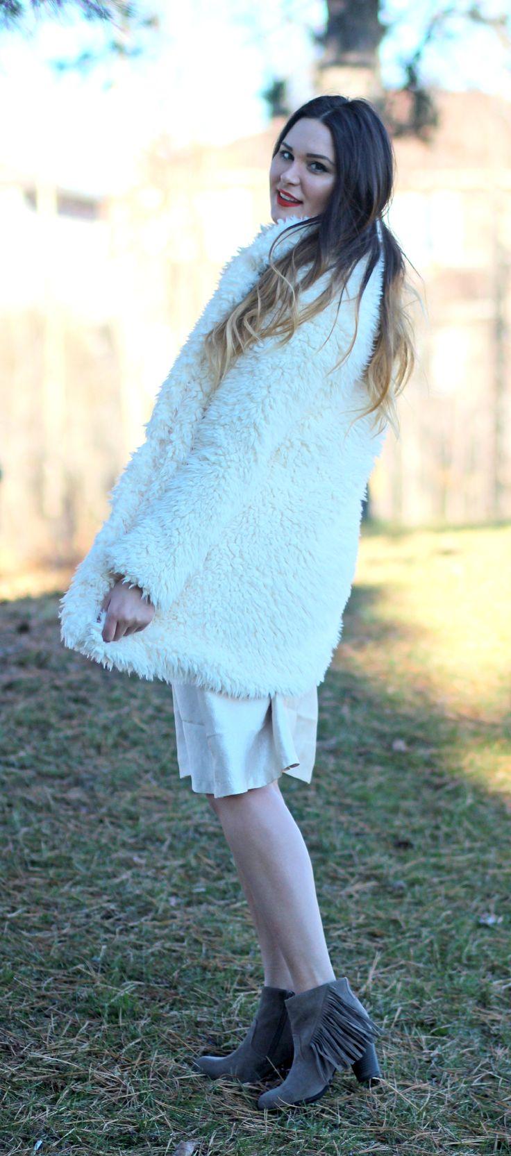 How to dress up a faux fur coat.   Mash Elle