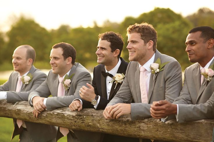 Groom and his groomsmen looking smart at this country styled wedding
