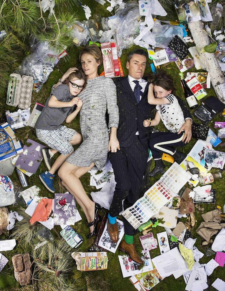 Mesmorizing photoshoot of people lying in a weeks worth of their trash