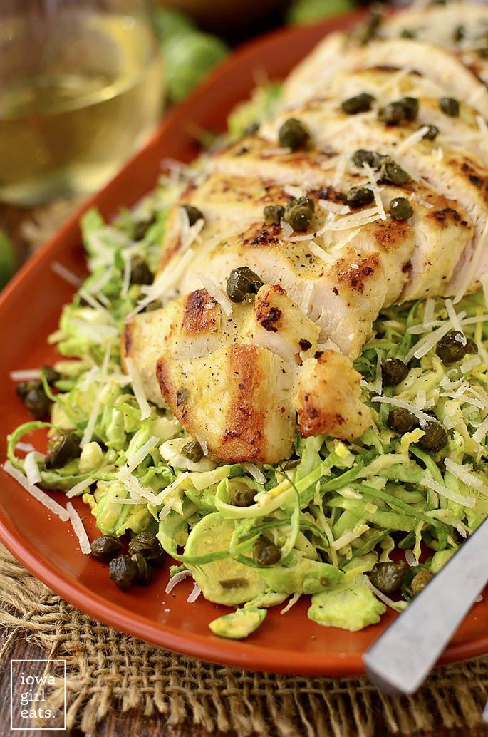 Shredded Brussels Sprouts & Chicken Caesar Salad with crispy capers is a healthy, gluten-free take on Caesar Salad with lots of crunch and flavor! | iowagirleats.com