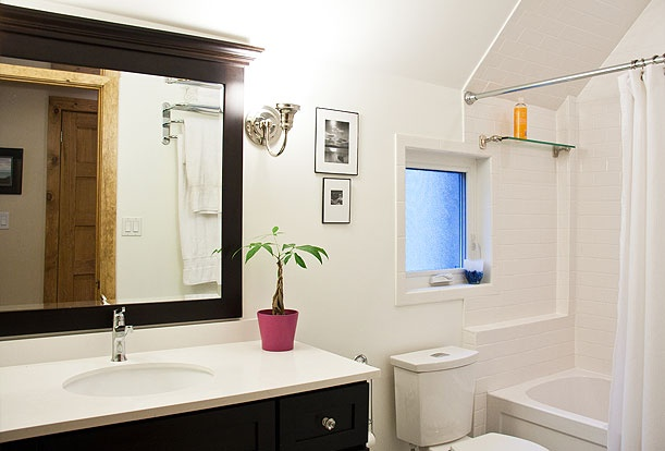 Brock Street Renovation - The second floor bathroom takes advantage of a small original window to bring natural light into the space.