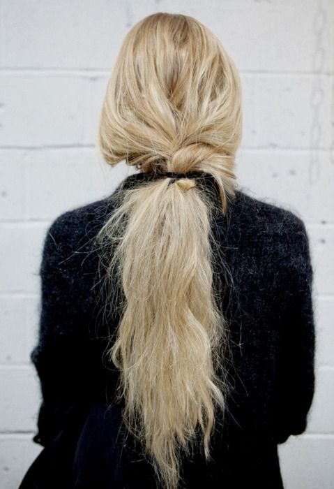 messy low ponytail with just a hint of a braid