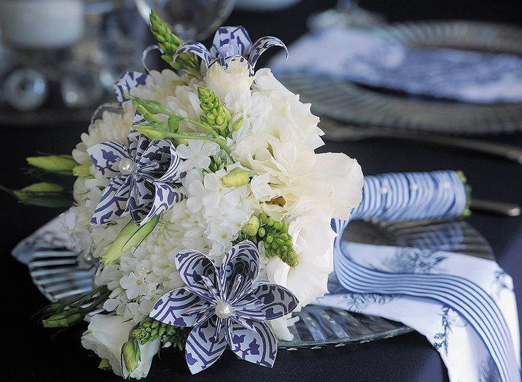 Add some origami flowers to your bridal bouquet to add the perfect touch of colour. Photos by: Natalie Gabriels. Decor styling & Flowers: DiNique Emporium