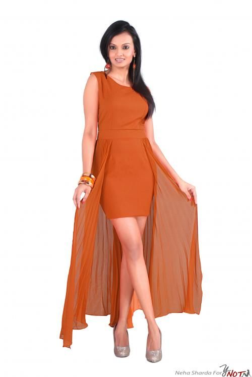 Orange Short Dress With Flared Georgette Long Panel By : Neha Kamal Sharda Description   This outfit is a soothing orange fitted short dress with flared georgette long panel open in the front . A belt on the waist of the same fabric enhances the look and fit of the garment.