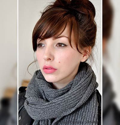 A Messy Bun and a Bangs  If you want to rock a bun but you are not that confident with your face shape, you can do a face-framing bun by doing a higher bun and pulling out a few hair strands towards your forehead.