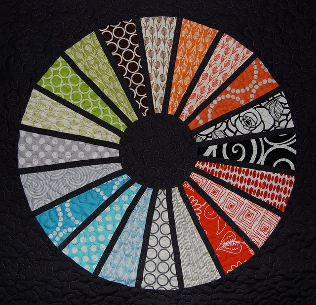 "A mini QAL quilt by Lynne @ Lilys Quilts: ""I cut each leaf using my dresden ruler then added a skinny charcoal strip between each one and pieced the inner and outer circles in rather than appliqueing them so the circle just floats there"""