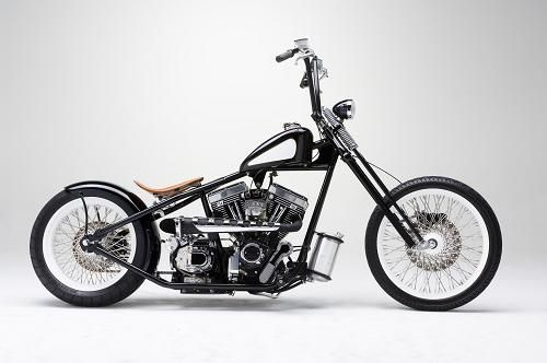 bobber-chopper.  Nice stance.  Love the moon tank as the oil bag.