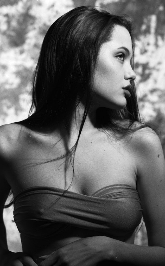 Angelina Jolie | brave & beautiful - inside & out...read her brave story on e!online http://www.eonline.com/news/418466/angelina-jolie-reveals-having-double-mastectomy-to-prevent-breast-cancer #angelinajoie #breastcancer #fighter
