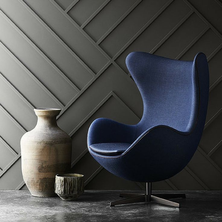Like the contrast of the blue against the grey accent wall. Compliments nicely the modern feel of the chair with the antique vases.