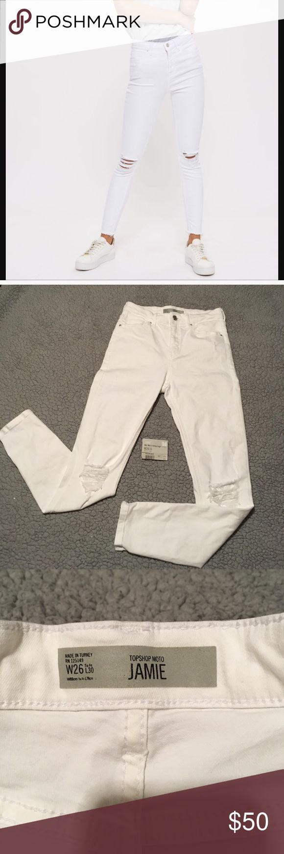"""TopShop Moto Jamie White High Rise Jeans Size 26 Perfect NWT Detached jeans. Jamie High Rise Moto Ripped Jeans. Size 26 or women's 2. Bright white. Great rips in great places! Waist is 12"""" across, inseam is an ankle grazing 26"""". Very high rise of 10"""". Crafted from a super-stretchy white cotton blend for our signature soft denim feel, the iconic style includes multiple pockets, a top button fly and ripped knees for an added edge. 91% Cotton, 6% Polyester, 3% Elastane. Bundle offer and save…"""