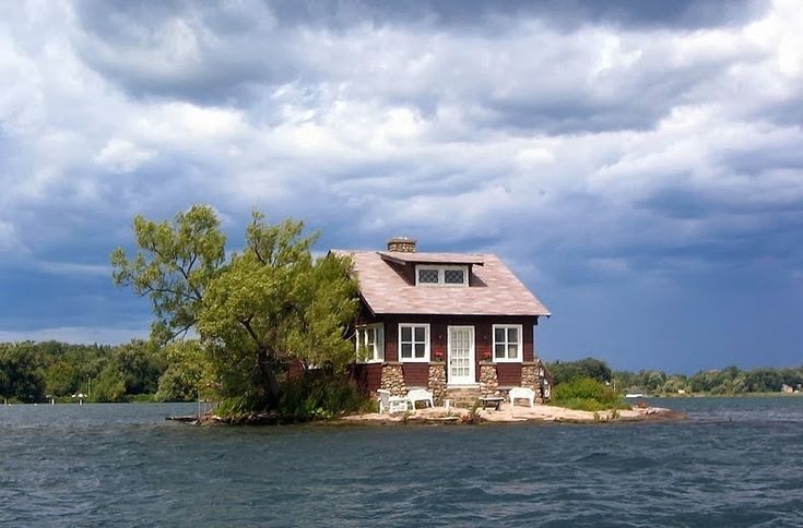 Just Enough Room Island - thousand-islands.  The Thousand Islands is an archipelago consisting of exactly 1,864 islands that straddles the Canada-U.S. border in the Saint Lawrence River as it emerges from the northeast corner of Lake Ontario. They stretch for about 80 km on St. Lawrence Seaway, but the largest clustering of islands falls between Cape Vincent and Alexandria Bay in the United States and Kingston and Rockport in Canada.