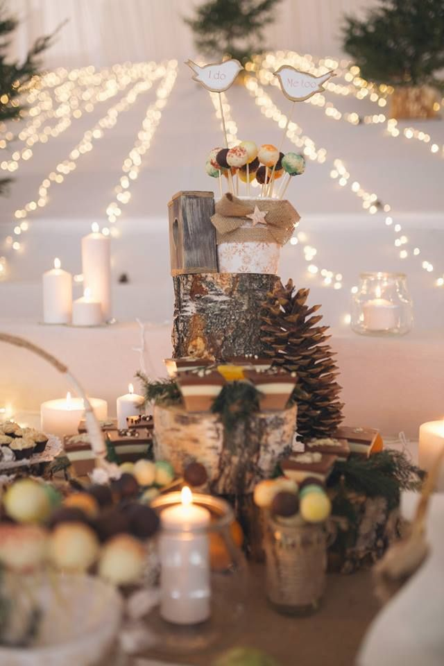 Candy bar decorations from one of our favourite winter weddings. Pine cones, tree logs, candle lights and sweets.