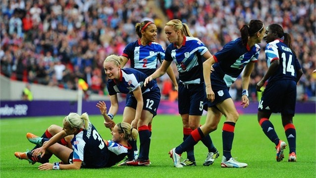 Stephanie Houghton of Great Britain celebrates with her team mates after scoring the opening goal during the women's Football first round match between Great Britain and Brazil on Day 4 of the London 2012 Olympic Games at Wembley Stadium.