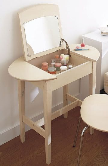 Move makeup vanity into main bath and place bowl sink on small bath vanity?