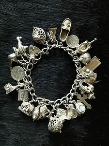 Sterling Silver charm bracelet - we added charms to remember special events and vacation stops.: