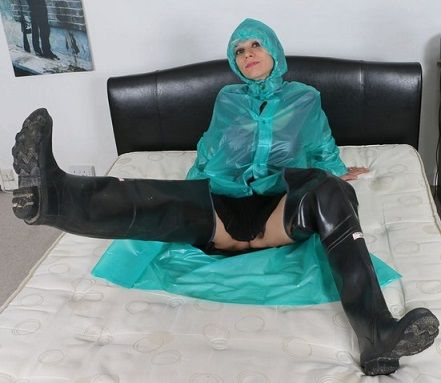 Waders and rain coat on bed