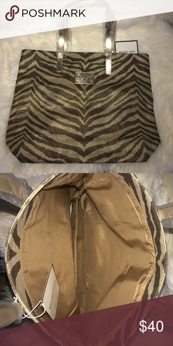 🦋Michael Kors 🦋metallic tiger stripe tote bag New Michael Kors tiger striped tote bag. No trades. MICHAEL Michael Kors Bags Totes