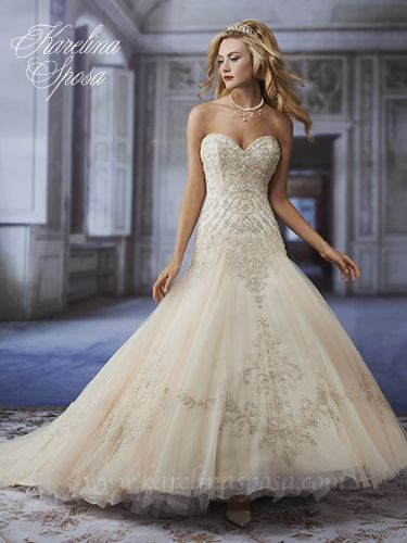 Style C7952: A strapless trumpet bridal gown made of crystal, re-embroidery, and French tulle with a sweetheart neckline and chapel train, features embroidery embellished with bead and sequin bodice and waist detail.