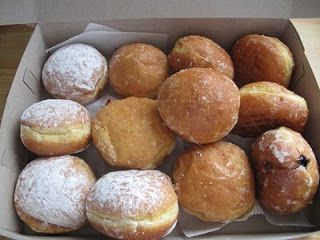 Paczki Day Roundup | Core Detroit :: Call it Mardi Gras, Fat Tuesday, or Paczki Day. This Tuesday, March 4, Metro Detroiters will be lining up at their favorite bakeries for a taste of the delicious fried donuts we know as pazcki. Traditionally filled with fruit preserves, jelly or custard, the famously calorie-laden donuts are dusted with powdered sugar or glazed with icing. Many Michiganders associate paczki with Hamtramck, which isn't a bad thing IMO.