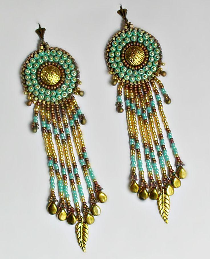 Szinei: arany, kék és egy kis khaki iris     A fülbevaló mérete 12 cm akasztóval együtt     Hátoldala puha, arany, valódi bőr