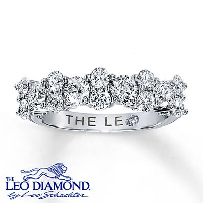 One and one-quarter carats of near-colorless Leo diamonds decorate the 14K white gold band of this irresistible wedding ring for her. Independently Certified and laser-inscribed with a unique Gemscribe® serial number. The inside of the band features a round diamond within the Leo signature.
