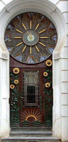 This would probably need a certain type of building to go good on, but it is wonderful!! Not sure what is better, the sunflower or clock transom!